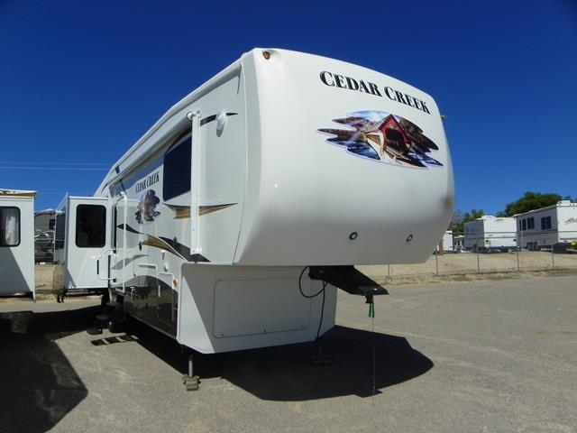 Used 2013 Forest River Cedar Creek 36RE Fifth Wheel For Sale