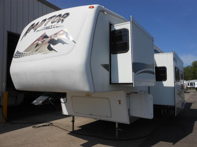 Buy a Used Keystone Raptor in Houghton Lake, MI.