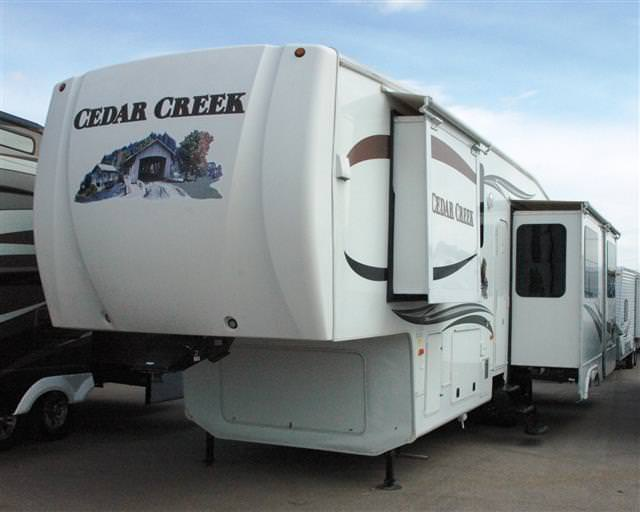 Used 2010 Forest River Cedar Creek 36RD5S Fifth Wheel For Sale
