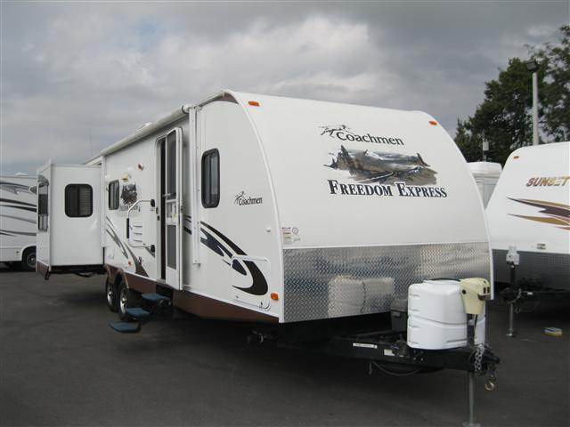 Buy a Used Coachmen Freedom Express in Holiday, FL.