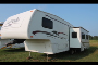 Used 2004 Keystone Laredo 27RL W/SLIDE Fifth Wheel For Sale