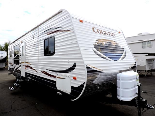 Used 2012 Heartland North Country 29RKS Travel Trailer For Sale