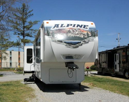 Used 2012 Keystone Alpine 3555RL Fifth Wheel For Sale